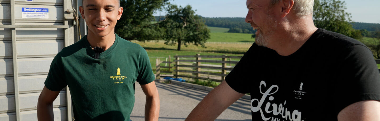 Photo of Robert Nicholson talking to a team member at Cannon Hall Farm